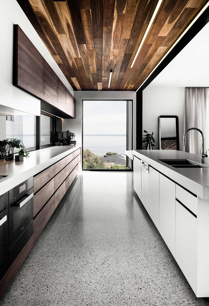 "**Material palette** Throughout the house a rich material palette adds depth and textural playfulness to the contemporary design. Spotted gum is paired with [polished concrete floors](https://www.homestolove.com.au/a-guide-to-concrete-flooring-16194|target=""_blank""), timber joinery and white walls."