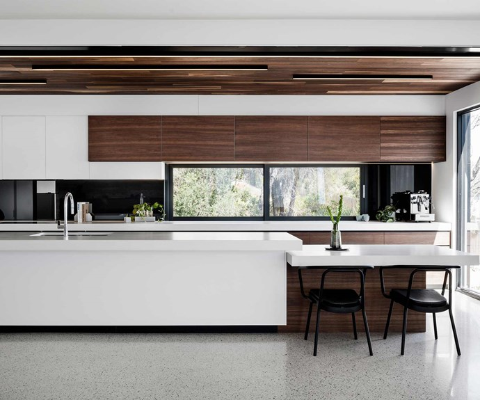 "**Kitchen** The [kitchen space](https://www.homestolove.com.au/kitchens-with-clever-design-ideas-to-steal-6962|target=""_blank"") makes the most of the home's material palette, with [white benchtops](https://www.homestolove.com.au/kitchen-benchtop-guide-19237
