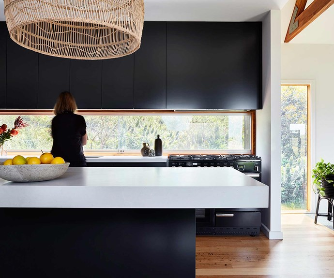 "**Kitchen** The [kitchen](https://www.homestolove.com.au/kitchen-benchtop-guide-19237|target=""_blank"") features a simplistic palette with a woven rattan pendant lamp over the kitchen island. Simple and sleek black [cabinetry](https://www.homestolove.com.au/knockout-kitchen-cabinetry-10-bold-colour-ideas-17864