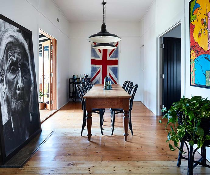 "**Dining space** Artwork lines the walls of this dining space, and black bentwood dining chairs are paired with a heavy timber dining table.  *Design: [Bryant Alsop](https://www.bryantalsop.com.au/|target=""_blank""