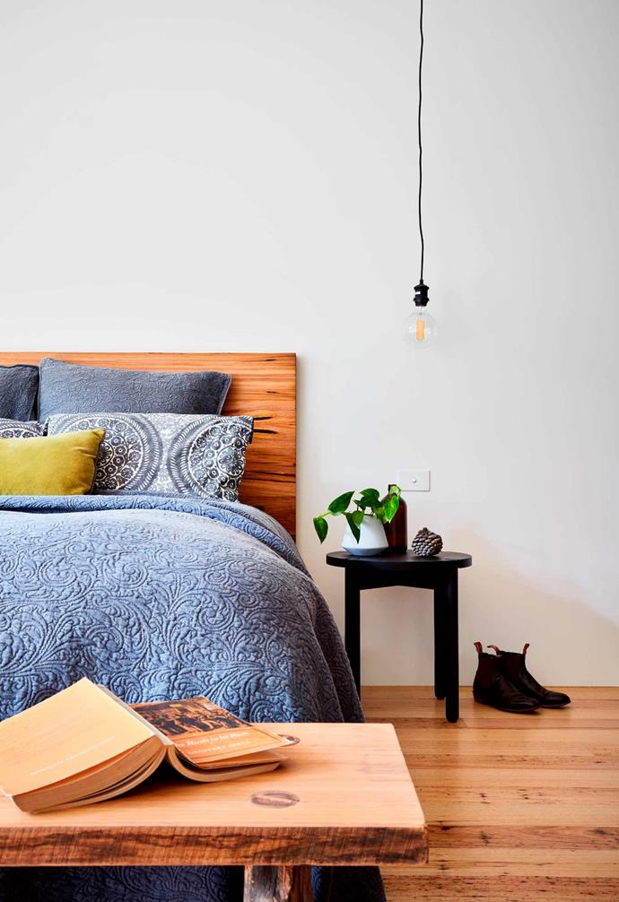 """**Bedroom** The rustic style of the home is continued in the bedroom with ample timber furnishing including the timber bedhead and bench at the foot of the bed.  *Design: [Bryant Alsop](https://www.bryantalsop.com.au/ target=""""_blank"""" rel=""""nofollow"""")   Photography: Rhiannon Slatter*."""