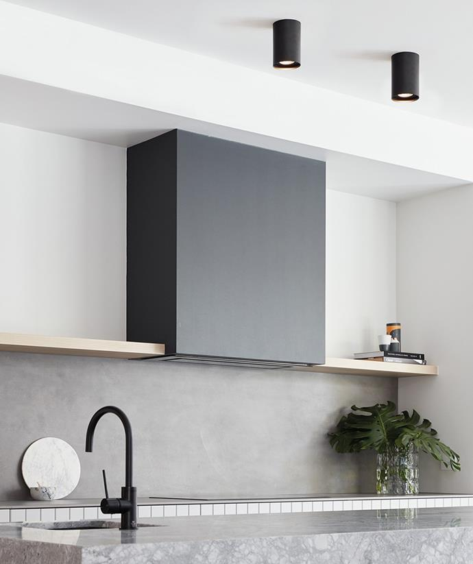 The perfect balance of functional and chic, these industrial down lights project optimal lighting in the kitchen space. *Image / supplied*