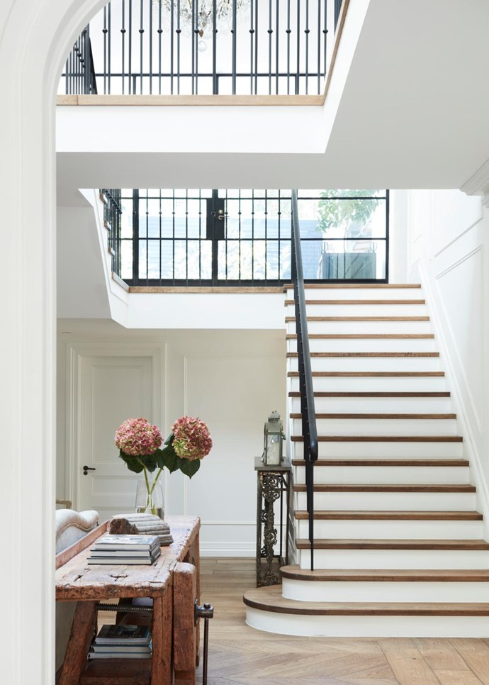 """Not only is this a beautiful staircase clad in oak parquetry, but its atrium design also bathes the home's entrance and sitting room with natural sunlight. The [Gothic revival home](https://www.homestolove.com.au/gothic-revival-home-19307