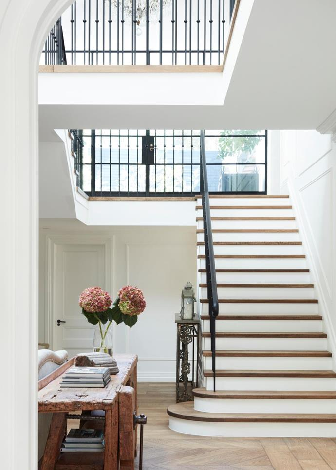 "Not only is this a beautiful staircase clad in oak parquetry, but its atrium design also bathes the home's entrance and sitting room with natural sunlight. The [Gothic revival home](https://www.homestolove.com.au/gothic-revival-home-19307|target=""_blank"") was restored by Hancock Architects and Alwill Interiors. *Photo: Prue Ruscoe / Styling: Alexandra Gordon / Story: Belle, November 2018*"
