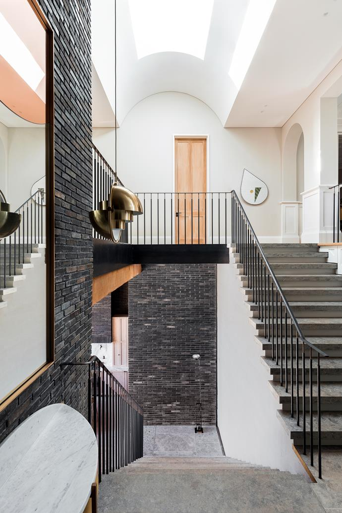 "The staircase in this [restored heritage Sydney home](https://www.homestolove.com.au/exposed-brick-extension-for-heritage-sydney-home-18900|target=""_blank"") signals the connection between the original section of the home and its exposed-brick, ultra-modern extension. Architect Telly Theodore says his use of brick was inspired by other buildings in the local area. *Photo: Tom Ferguson / Story: Belle, August/September 2018*"
