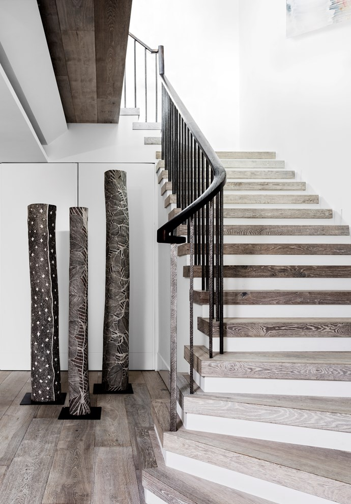 "African and Asian antiques soften the hard lines of this staircase in a [high rise haven](https://www.homestolove.com.au/a-high-rise-haven-in-sydney-4268|target=""_blank"") designed by Thomas Hamel & Associates. *Photo: Felix Forest / Story: Belle, February/March 2016.*"