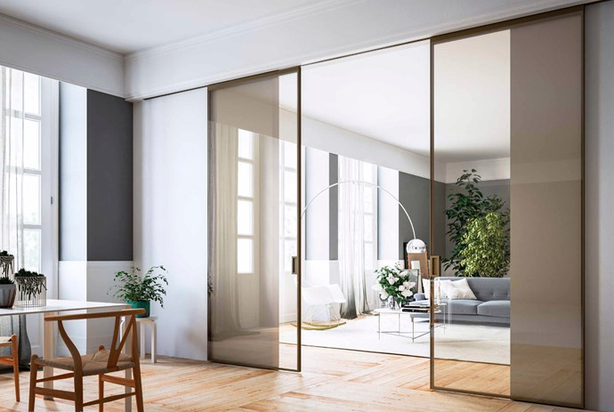 "Open-plan spaces are the standard in modern homes, but maintaining a level of privacy is important for some families. Barely there sliding doors can reduce noise without compromising natural light. ADL 'Piana' double sliding doors with anodised-aluminium frame and safety glass from [Exclusive Doors](https://exclusive-doors.com.au/|target=""_blank""