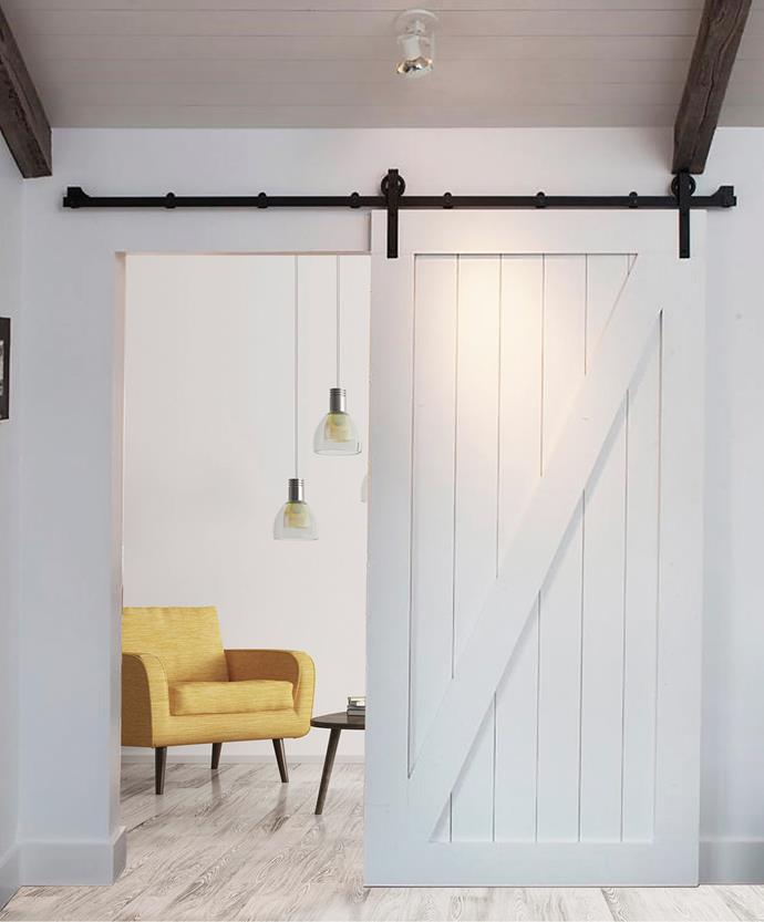 "[Barn doors](https://www.homestolove.com.au/maximise-space-and-style-with-barn-doors-6582|target=""_blank"") have been trending for years, with good reason. Not only are they a space-saver but are affordable and easily self-installed. *Photo: [Parkwood Doors](https://parkwooddoors.com.au/