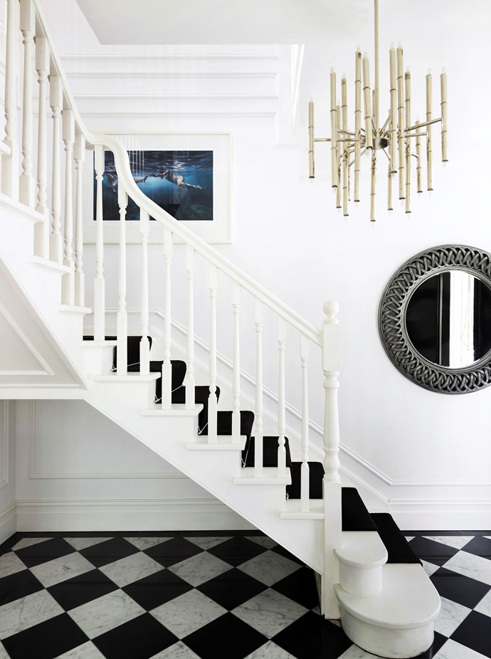 """The imposing black-and-white staircase sets the scene for the entire [luxurious regency style home](https://www.homestolove.com.au/gallery-emma-and-tonis-luxurious-regency-style-home-2311