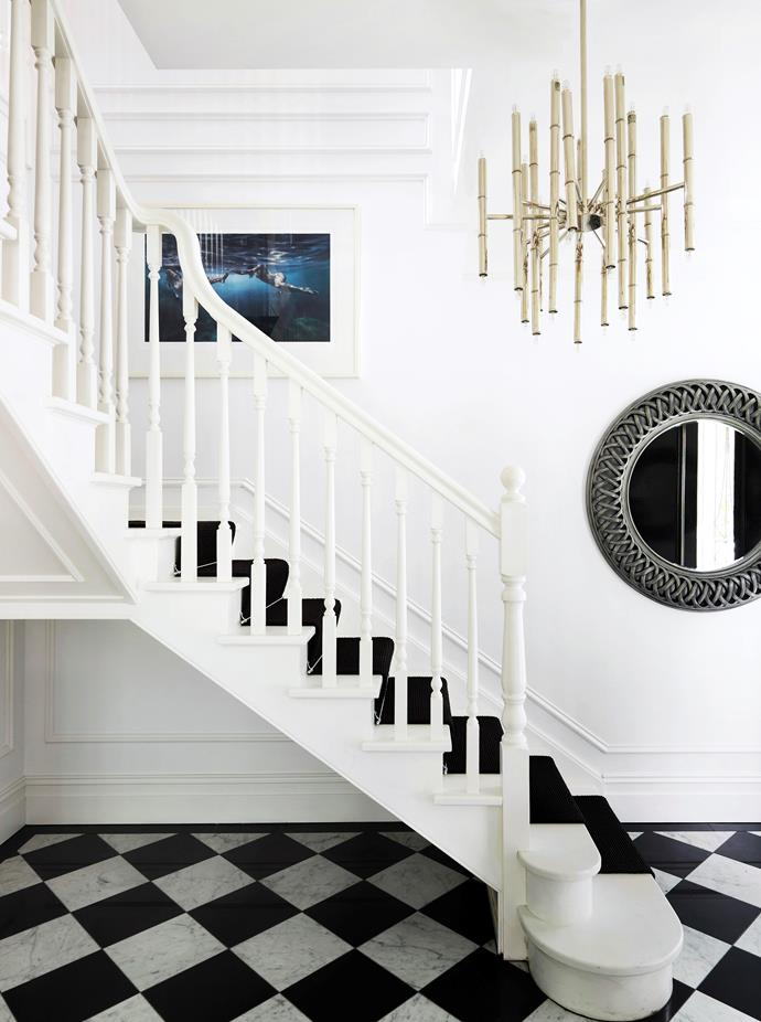 "The imposing black-and-white staircase sets the scene for the entire [luxurious regency style home](https://www.homestolove.com.au/gallery-emma-and-tonis-luxurious-regency-style-home-2311|target=""_blank""), designed by Greg Natale. *Photo: Anson Smart / Story: Belle, June/July 2013*"