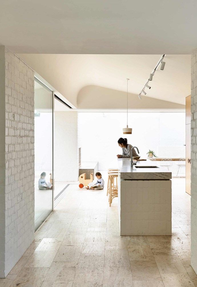 "**Material palette** To ensure consistency between the original home and the new addition, a simple material palette of white [painted brick](https://www.homestolove.com.au/painted-brick-home-exterior-6695|target=""_blank"") and unfilled saw-cut travertine was used throughout the extension. *Design: [Kennedy Nolan](http://www.kennedynolan.com.au/