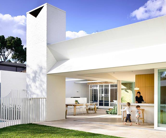 """**Process** The project was executed in two main stages: an interior refurbishment of the existing house, which was then followed by the major addition of kitchen, dining, living and [swimming pool](https://www.homestolove.com.au/swimming-pool-installation-18898