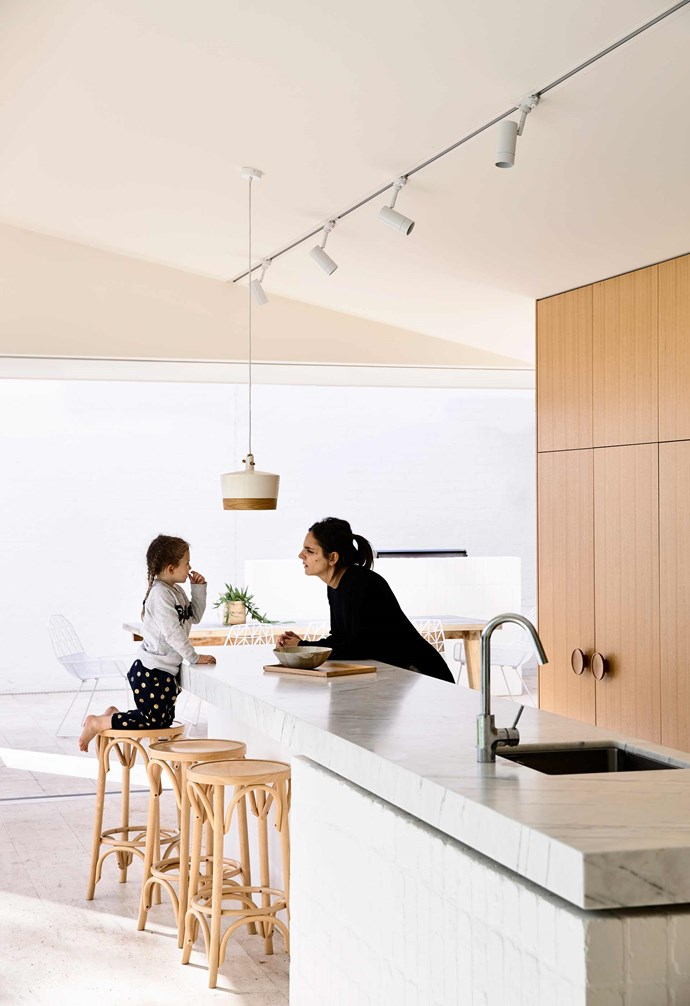 "**Kitchen** Timber [bar stools](https://www.homestolove.com.au/best-bar-stools-19030|target=""_blank"") pair with the timber cabinetry in this mostly-[white kitchen](https://www.homestolove.com.au/best-white-kitchens-17040