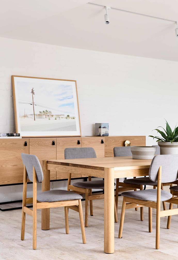 """**Dining room** Timber furniture choices warm up the mostly-white interior in this dining room. *Design: [Kennedy Nolan](http://www.kennedynolan.com.au/