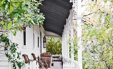 Inside a white weatherboard cottage full of antiques in rural Victoria