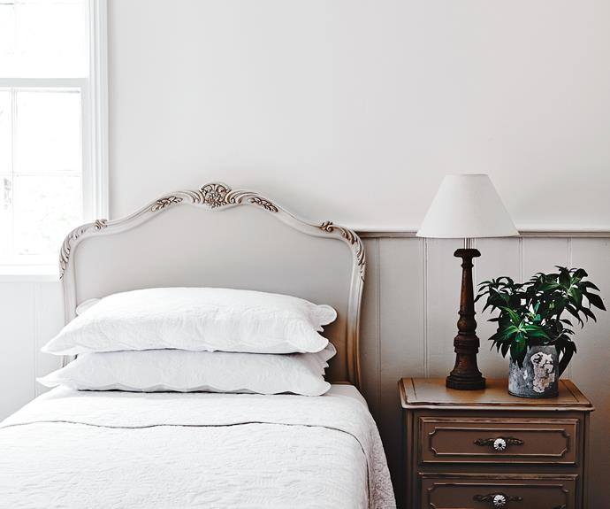 """Liz bought this 1950s French-style bedhead in the guestroom at a clearing sale. Dulux Opal White is also the trusted colour Liz and Doug use to set off their [antique furniture](https://www.homestolove.com.au/how-to-make-antiques-work-in-a-modern-home-6616