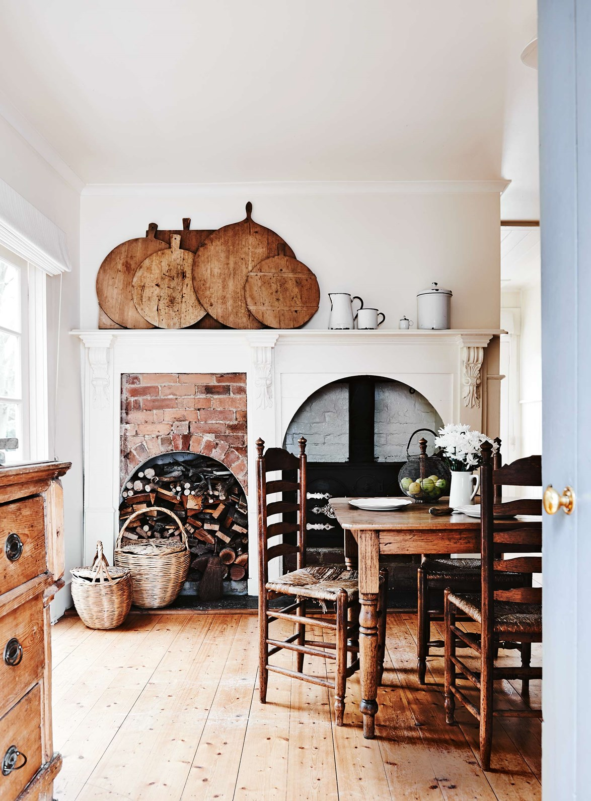 "<p>**FRENCH COUNTRY **<p> <p>Imagine winter nights dining here: the fire is crackling and the room is aglow with warmth. True to the [French country](https://www.homestolove.com.au/french-country-style-13845|target=""_blank"") aesthetic, timber is the hero. Everything in the room, from the collection of chopping boards to the wicker baskets, have a delightfully worn-in patina. This is the kind of dining room is timeless, and will retain its beauty over a lifetime.<P> <P>*Photo: Lisa Cohen*<p>"