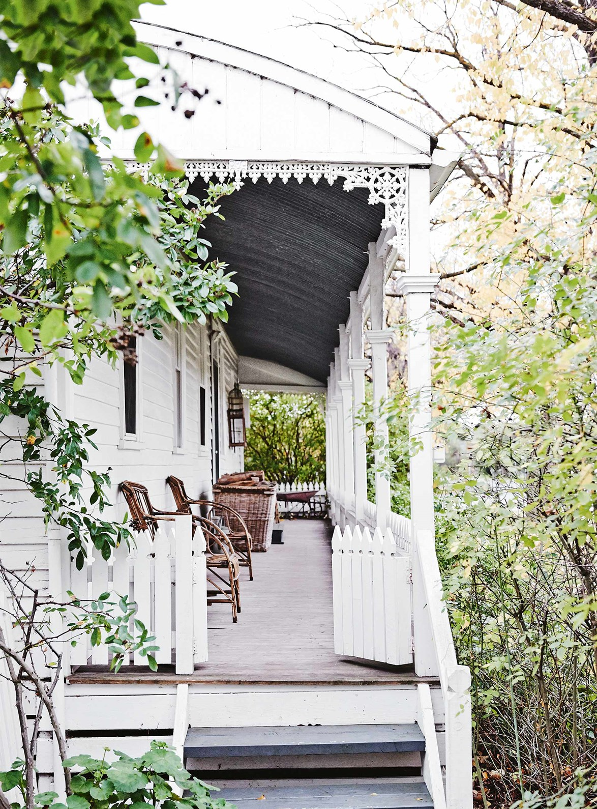 "The owner of this [white weatherboard cottage](https://www.homestolove.com.au/white-weatherboard-cottage-victoria-13741|target=""_blank"") in rural Victoria repurposed these white gates to enclose her verandah. ""They're from my grandfather's farm and were on the sheep-drafting race - I remember hanging off them as a little girl,"" she says."
