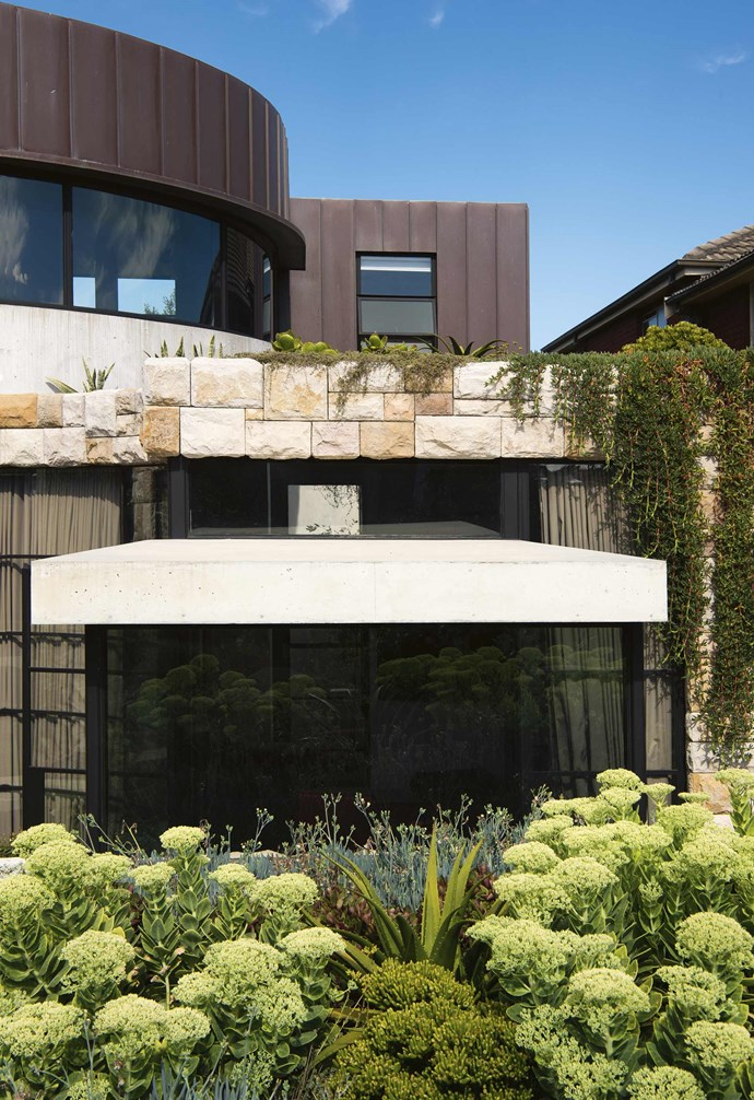 """The house blends [concrete walls and floors](https://www.homestolove.com.au/a-guide-to-concrete-flooring-16194