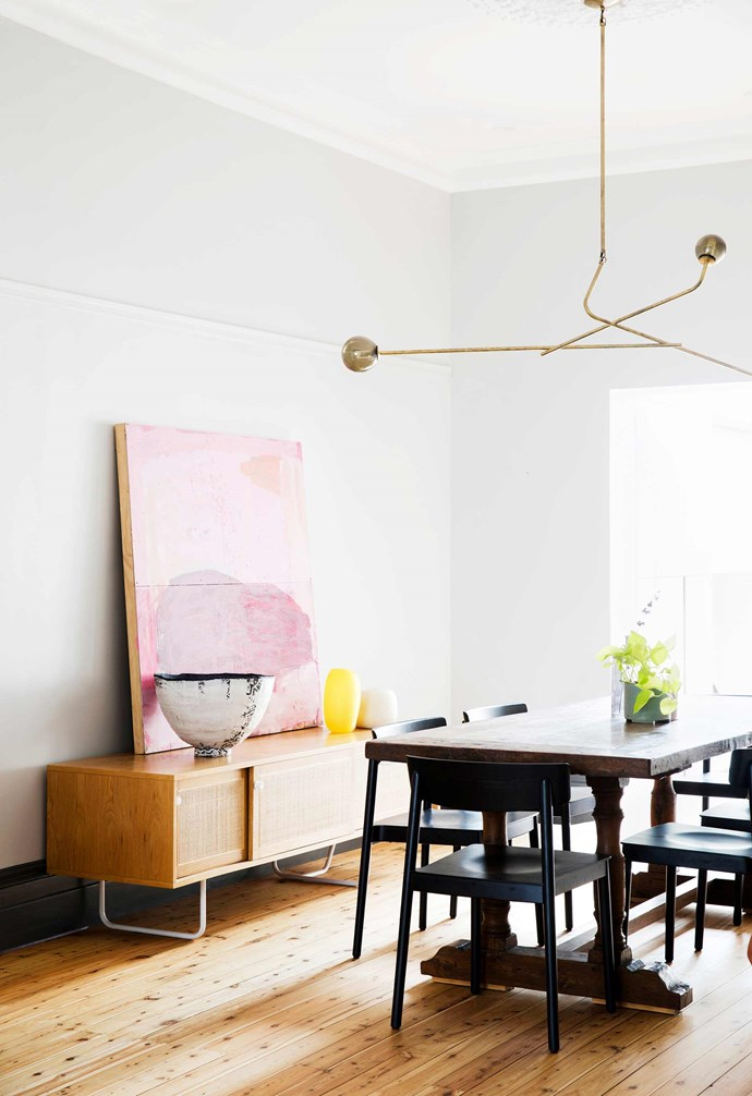 "**Dining** The 'Lattice' pendant by Neri and Hu from Spence & Lyda ""works especially well in this room"", Lara points out. A painting by local artist Zara Williams rests on a Jardan 'Iluka' sideboard, against walls painted in Dulux Brume."