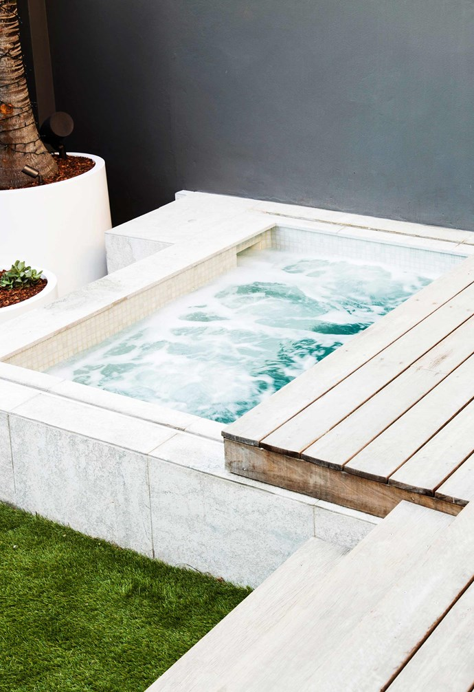 **Bright idea** The outdoor space was designed by Think Outside Gardens and includes a spa pool by Concept Pools Australia that hides away under retractable decking, offering more space when needed for entertaining.