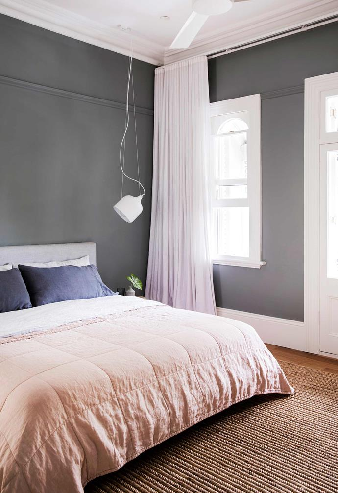 **Master bedroom** Grey hasn't been outlawed completely; here, walls, wardrobes and picture rails are painted in Dulux Wistow. LAAL 'Popper Tilted' lights suspended from the ceiling free up space on bedside tables and stand out crisply against the grey walls.
