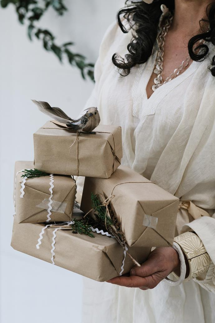 To fit this year's natural theme, the presents are simply wrapped in brown paper and twine, then decorated with ric-rac ribbon from the 1950s and pine-needle sprigs.
