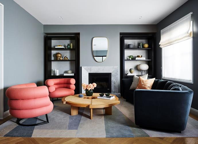 "A pair of coral armchairs punctuate an otherwise subdued blue living room in a Sydney home designed by [Arent & Pyke](https://www.homestolove.com.au/colourful-california-bungalow-by-arent-and-pyke-4946|target=""_blank""). *Photo: Anson Smart / Styling: Steve Cordony*"