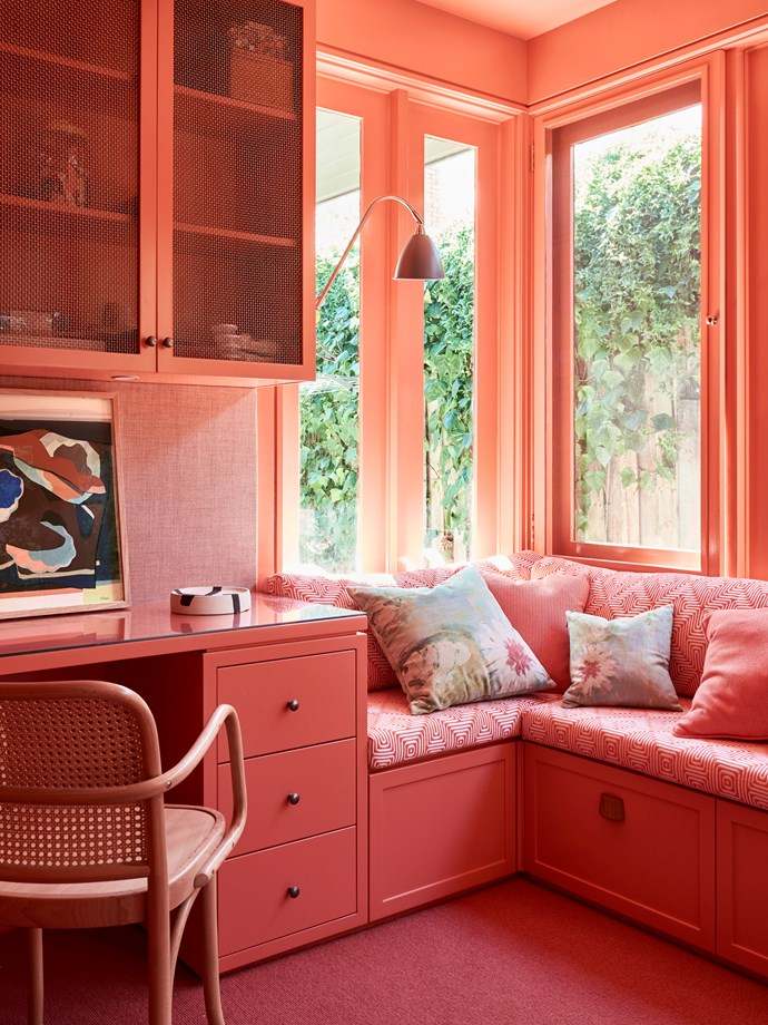 "All coral everything. Everything about this home office and reading nook designed by [Chelsea Hing](https://www.homestolove.com.au/interior-designer-chelsea-hings-bayside-melbourne-terrace-5879|target=""_blank"") is peachy. The designer is known for her brave colour choices, particularly in homes of generous size and scale. *Photo: Eve Wilson*"