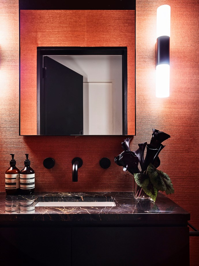"Following the revamp of her Sydney home by [Poco Designs](https://www.homestolove.com.au/colour-revamps-a-sydney-federation-3613 |target=""_blank""), one thing is clear: Skye Leckie is not afraid of colour. Her bathroom is just one striking example; lined with luxe coral wallpaper and featuring a dramatic black marble vanity. *Photo: Anson Smart*"