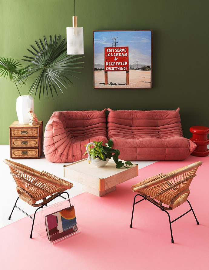 This living room looks good enough to eat! A watermelon colour palette feels fun and summery when combined with a pair of rattan chairs. *Photo: Edward Urrutia / Styling: Steve Cordony*