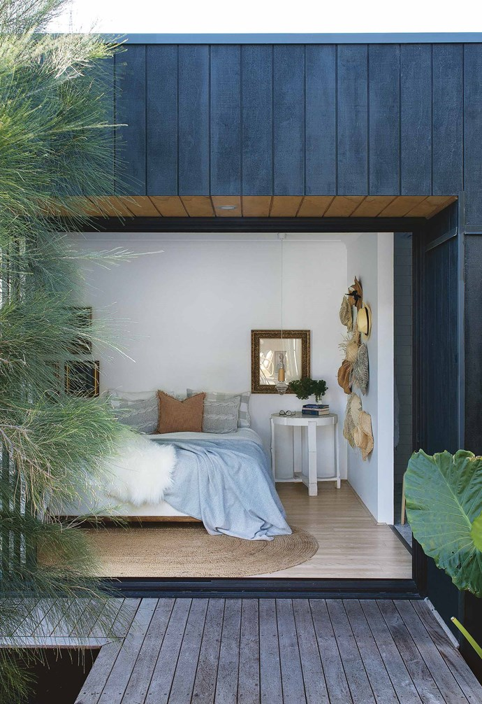 """""""Much like in Bali, this property exposes us to the elements, which makes us feel alive and connected,"""" says Malvina. """"We throw open all the doors and spend the day moving seamlessly from space to space. I reckon we'd spend at least half the day outdoors, depending on the weather. Even in the winter it's beautiful.""""<br><br>**Star performer** Sometimes, the simple things stand out most of all. Given the dark exterior, Malvina selected Dulux Lexicon Quarter for the walls, ceiling and cabinetry throughout, for contrast and to make a small space feel much lighter and larger."""