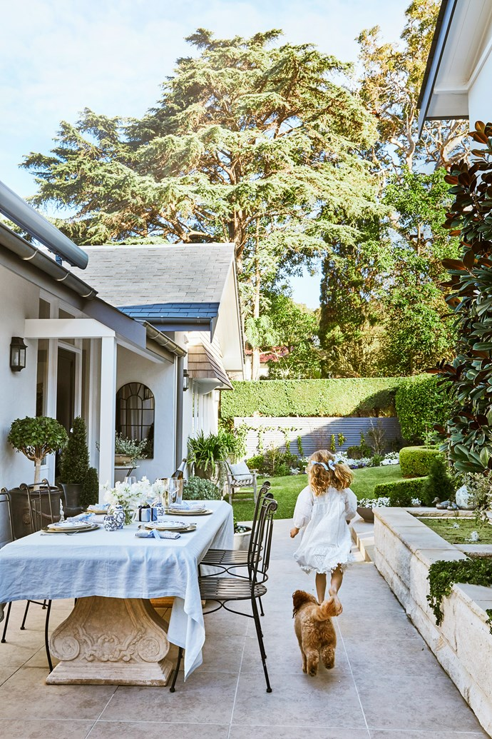 """The courtyard is paved with stone-look porcelain from Armstone. """"We opted for porcelain pavers because they don't require any maintenance,"""" says Judy."""