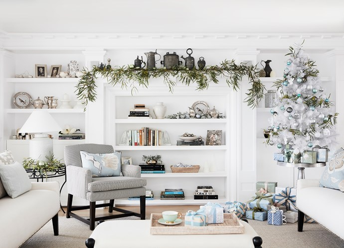 The built-in shelving is original to the house; its detail inspired the design of the joinery throughout the home. Judy bought the armchair and silver side table years ago. Assorted decorations from Myer, Big W, My Christmas and Ivory House.