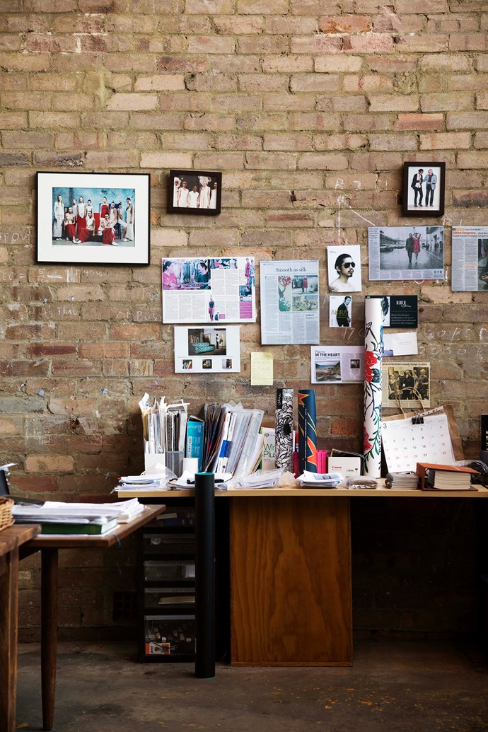 Photographs from parades and magazine tearsheets are displayed on the brick walls.