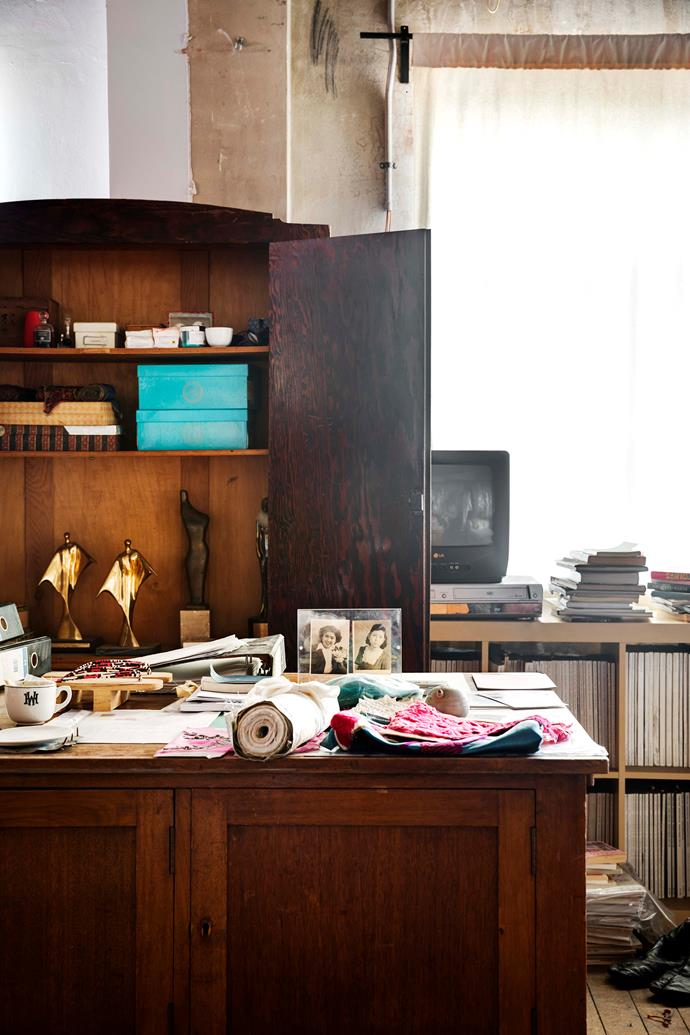 Akira's desk holds personal items such as his mother's Geta wooden shoes and family photos.