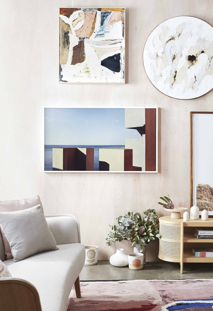 Samsung's The Frame fits perfectly into this gallery wall, featuring art by Nacho Allegre. *Styling: Jono Fleming and Natalie Johnson | Production: Mia Daminato | Photography: Sam McAdam Cooper*