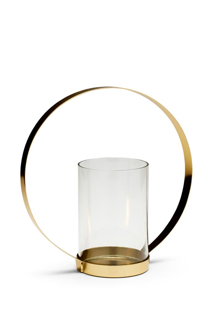 "Add festive flair to your table with a sculptural candleholder in iron and glass. The curved handle makes it easy to carry on and off the table and, at 27cm high, it's a centrepiece in its own right. <br><br> Glow 'Halo' candleholder in Gold, $35, [Salt & Pepper](https://www.saltandpepper.com.au/|target=""_blank""