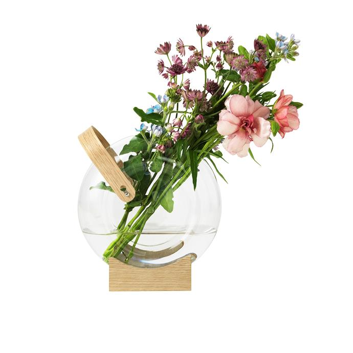 "Arrange a curated floral arrangement in this vessel of quality borosilicate glass. The handle and base – in FSC-certified oak – give this 18cm vase a charming, basket-like feel. Use it to create a fun, quirky vibe when you dress a casual yet chic table.  <br><br> Mater 'Handle' vase, $228, [Cult](https://cultdesign.com.au/|target=""_blank""