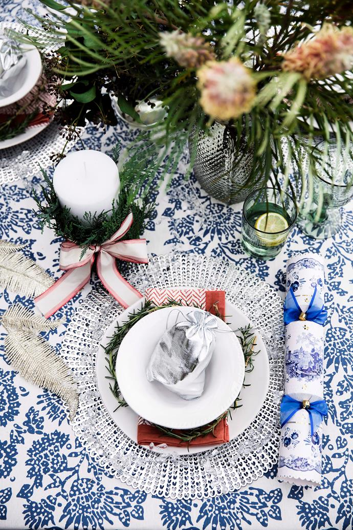 Flowers and foliage aren't reserved for vases. Scatter springs down the centre of the table or add a decorative touch to your table setting. Photo: Maree Homer