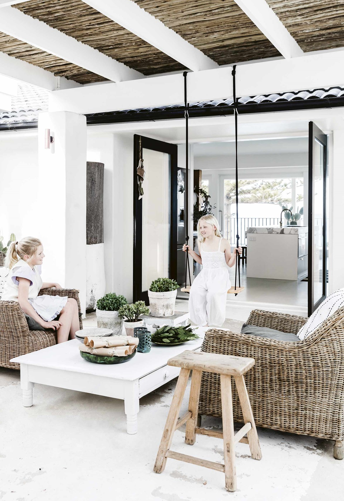 "A seamless connection to the outdoors and a comfortable area to relax, entertain and dine alfresco is essential when creating a Mediterranean style home. Overlooking Bungan Beach on Sydney's Northern Beaches, this breezy, [all-white home](https://www.homestolove.com.au/mediterranean-style-all-white-home-16945|target=""_blank"") has all the makings of a luxe holiday retreat in Santorini, with its resort style pool, outdoor shower and plenty of places to lounge around."