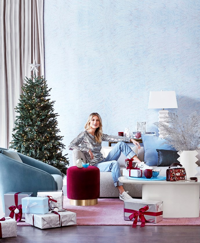 Farrah Occasional chair in Peppermint, $980, GlobeWest. Superellipse coffee table, $599, West Elm. Taylor ottoman in Velvet Burgundy, and Bower console table, Fenton&Fenton. Balsam Fir Christmas tree with LED lights (180cm), $899, Balsam Hill, with Star Tree topper in Silver, $3, Koch & Co. Paper and ribbon, Vandoros Fine Packaging.