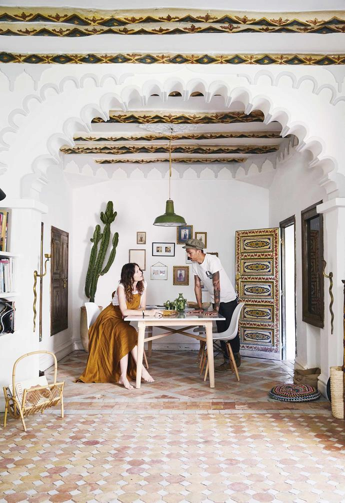 **Dining area** A traditionally ornate Moroccan archway creates a striking entry to the space while earthen hues and rich textures add other authentic touches. Framed photographs, taken by Cyrielle on the couple's adventures, complement artworks sourced from flea markets around Marrakech. *Styling by Cyrielle Rigot | Photography: Armelle Habib*.