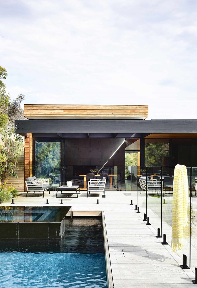 """The decks, designed to contribute to the coastal aesthetic, are constructed of large-profile blackbutt, which will silver up to the colour of driftwood and blend with the gravel pathways. The planting also matches the beach house vibe. The local council mandates a percentage of [plantings be indigenous to the area](https://www.homestolove.com.au/native-coastal-garden-plants-4685