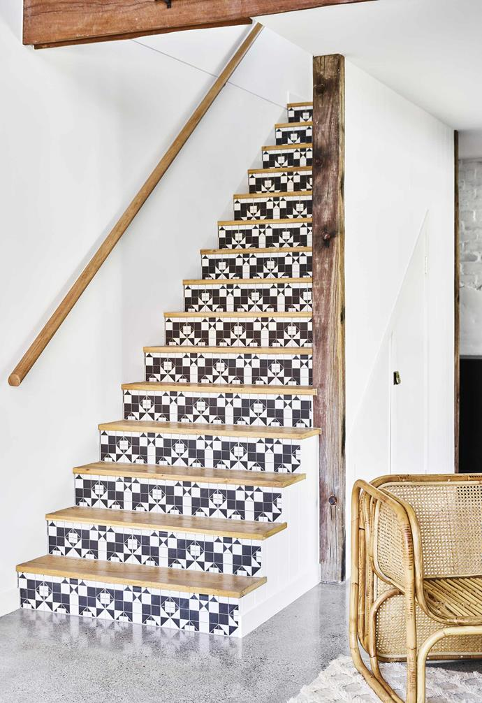 "**Step by step** A laundry is tucked away beneath the staircase that leads to the mezzanine bedroom. Geometric 'Arcade Harrow' tiles from [Beaumont Tiles](https://beaumont-tiles.com.au/|target=""_blank""