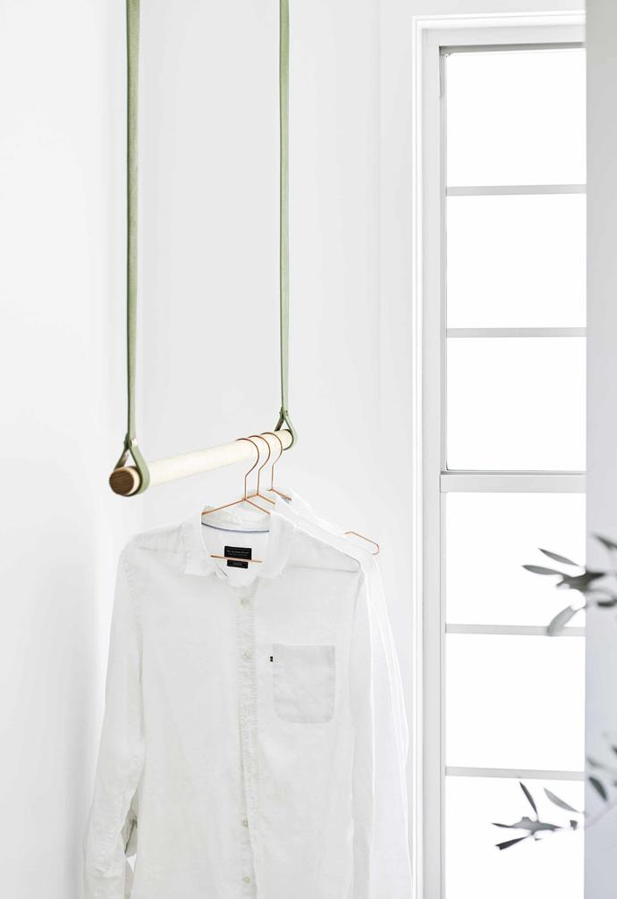 **On the rail** An elegant rail becomes the perfect makeshift wardrobe for guests.