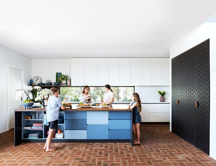 The command centre for Christmas lunch preparations features a benchtop in recycled Queensland spotted gum with joinery in vibrant shades of blue, Lisa's favourite colour. Custom chevron-striped doors reveal a coffee and cocktail station. Herringbone brick flooring was on Lisa's wish list. '