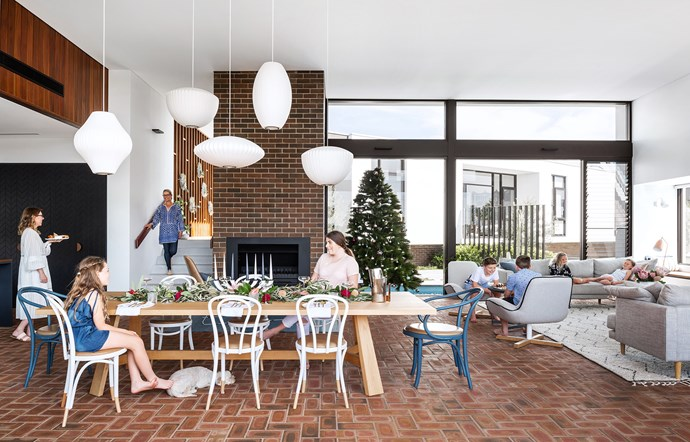 """Owner Lisa (far left), daughters Georgia and April (at the table, from left) and son Henry (with back to camera) love entertaining friends at home. Pet dog Taxi, a spoodle, often snoozes under the [Jardan](https://www.jardan.com.au/ target=""""_blank"""") dining table."""