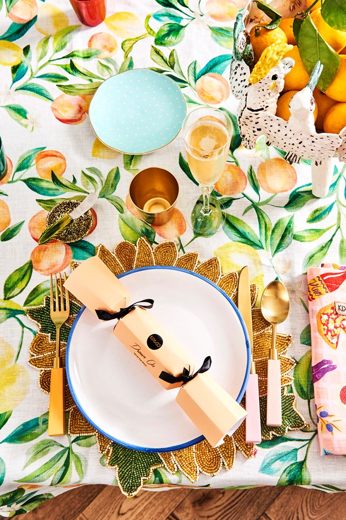 The table is set with a Peach Punch tablecloth, Camilla napkins, cutlery and bonbons, all from Kip&Co, along with place mats and metal cups from markets and op shops.