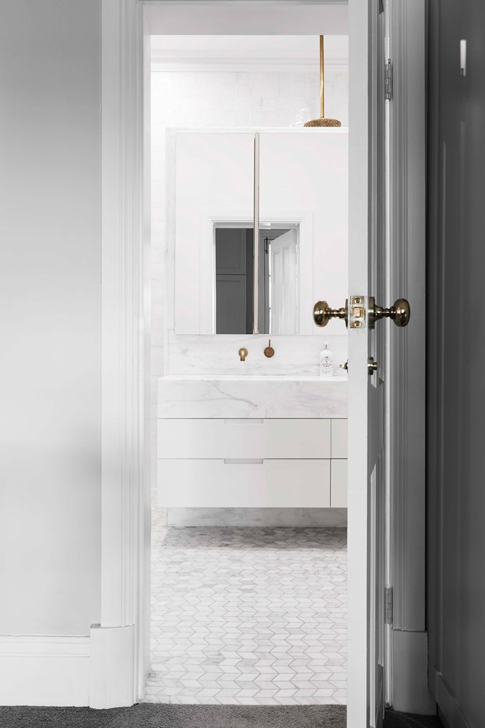 "The bathroom has chevron marble floor tiles in Ice Snow from [Italia Ceramics](https://italiaceramics.com.au/|target=""_blank""